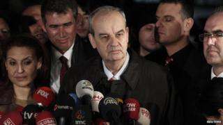 Former army chief Ilker Basbug (C) speaks to media after being released from prison outside Silivri prison complex near Istanbul on 7 March 2014.