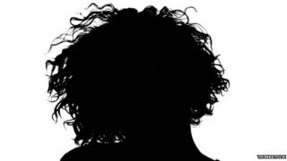 Silhouette of the back of a woman's head