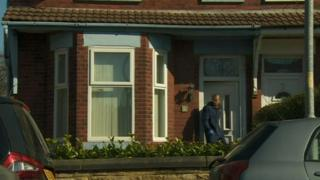 A house being searched by in the Levenshulme area of Manchester