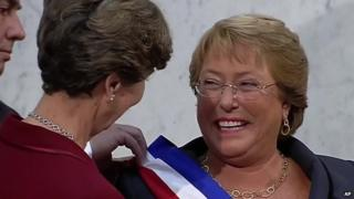 Michelle Bachelet (right) receives the presidential sash