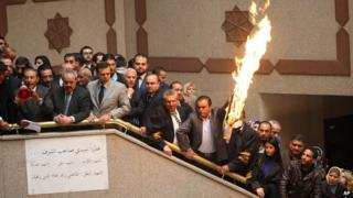Jordanian lawyers and judges burn a representation of the Israeli flag during a strike inside the Palace of Justice in Amman, Jordan, on 11 March 2014.