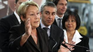 Parti Quebecois leader Pauline Marois (L) gestures during a campaign stop in Blainville, Quebec 10 March 2014