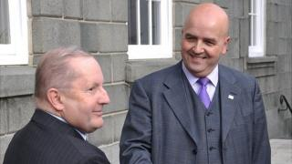 Deputies Allister Langlois (left) and Jonathan Le Tocq shake hands ahead of the vote for the position of Guernsey's chief minister