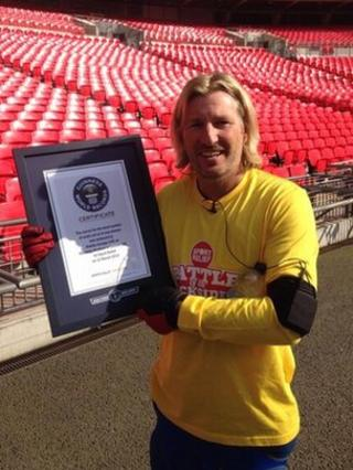 Robbie Savage wins world record for seat sitting