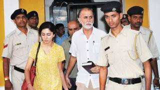 Indian magazine editor Tarun Tejpal (C) is escorted by police officials after a hearing at The High Court in Goa on March 4, 2014.