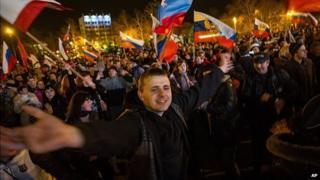 Pro-Russian people celebrate in the central square in Sevastopol, Ukraine