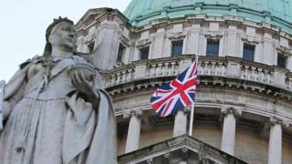 The union flag flying from Belfast City Hall