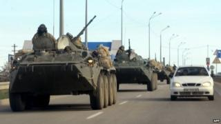 Russian armoured vehicles drive on the road between Simferopol and Sevastopol