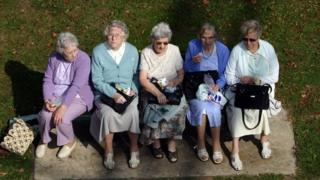 Five elderly ladies having lunch on a park bench in Alexandra Gardens, Windsor in this stock photo from 12/09/2007