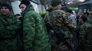 Armed Crimean defence forces stand outside naval training centre in Sevastopol. 19 March 2014