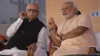 Gujarat chief minister and BJP PM candidate Narendra Modi, right, and senior party leader Lal Krishna Advani at the party workers' convention in Gandhinagar on Monday Feb 10, 2014.