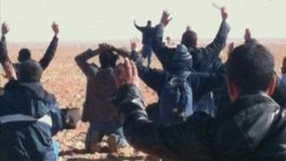 Hostages seen with their hands in the air at the Amenas gas facility in Algeria