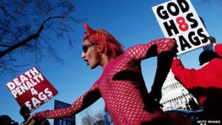 A drag performer dances in front of Westboro church members at the Supreme Court in 2013, as the court prepared to hear arguments regarding gay marriage