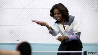 Michelle Obama plays table tennis during her visit of Beijing Normal School on 21 March 2014