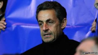 Former French President Nicolas Sarkozy watches a football match in April 2013.