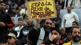 Algerians attend the gathering organised by opposition political parties calling for a boycott of presidential elections on 17 April