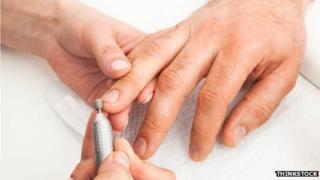 Man's hands being manicured