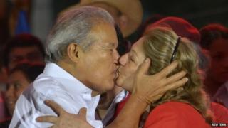 Salvador Sanchez Ceren, the presidential candidate for the Farabundo Marti National Liberation Front (FMLN), kisses his wife Margarita Villalta in San Salvador on 15 March, 2014