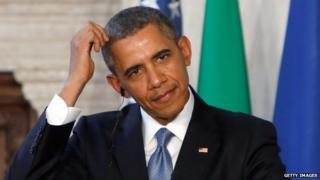 US President Barack Obama scratches his head during a press conference in Rome on 27 March, 2014.