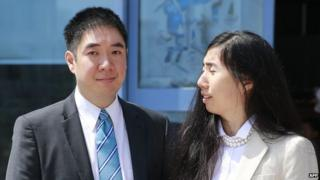 Matthew and Grace Huang outside the court in Doha, Qatar (27 March 2014)