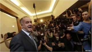 Andrej Kiska reacts as he arrives at the party election headquarters in Bratislava March 29