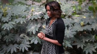 First Lady Michelle Obama listens to a performance on 25 March during a visit to China
