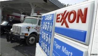 Exxon logo with truck in background