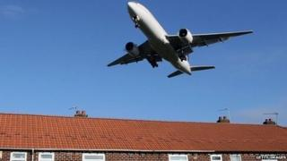 Aircraft over housing