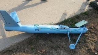 This picture released on 2 April 2014 shows wreckage of a crashed drone found on 31 March 2014 at South Korea's Baengnyeong island near the disputed waters of the Yellow Sea