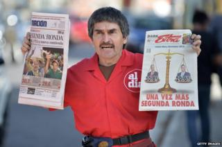 A vendor sells newspapers in the streets of San Jose on February 3, 2014 a day after Costa Rica held presidential elections
