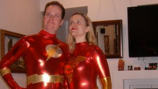 Jake Rush and his wife dressed as Superheroes