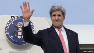 US Secretary of State waves as he boards an Air Force jet on 2 April, 2014.