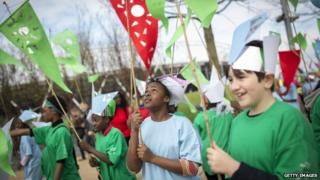 Local schoolchildren take part in an opening parade