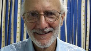 Alan Gross poses for a photo during a visit by Rabbi Elie Abadie as he serves a prison sentence in Havana in November 2012