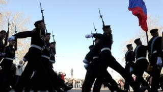 Russian naval infantry soldiers (marines) parade during the flower-laying ceremony at the Soviet-era World War II memorial in the Crimean port of Sevastopol on 3 April 2014