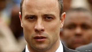 Olympic and Paralympic track star Oscar Pistorius arrives ahead of his trial at the North Gauteng High Court in Pretoria 9 April 2014