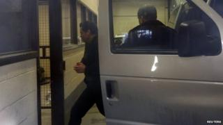 Suspended Senator Patrick Brazeau (left) is escorted into the court house in Gatineau, Quebec, on 10 April 2014