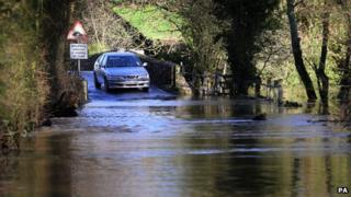 A car stops at flood waters in Kent