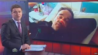 Screenshot of a news bulletin on NTV with an activist in a hospital bed