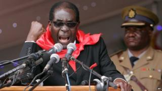 Zimbabwe's President Robert Mugabe delivers his speech during celebrations to mark his 90th birthday in Marondera, 23 February 2014