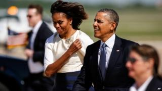 President Barack Obama and first lady Michelle Obama walk to greet supporters on the tarmac after landing aboard Air Force One at Austin-Bergstrom International Airport, in Austin, Texas, 10 April 2014