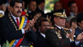 Venezuela's President Nicolas Maduro, left, and Operational Strategic Commander General Vladimir Padrino, right, on March 5, 2014.