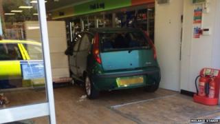 The car inside the Co-op shop