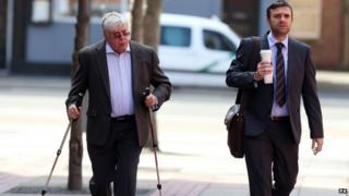 Sir David Jones and his son Stuart arriving at court