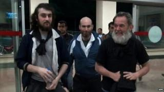 The four French journalists were pictured at a Turkish police station near the border with Syria - 19 April 2014