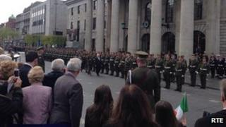 President Higgins inspects the guard of honour at the GPO
