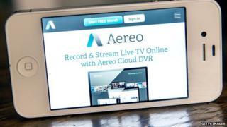 A smartphone displays the Aereo app.
