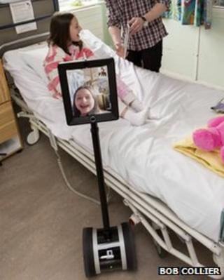 Child at Alder Hey hospital, Liverpool using an interactive robot
