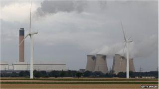 Wind turbines next to a coal power station