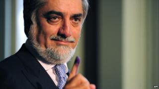 In this photograph taken on April 5, 2014, Afghan Presidential Candidate Abdullah Abdullah shows his inked finger as he casts his vote at a local polling station in Kabul